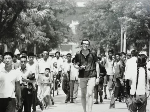Gil walking on a street in China, 1971