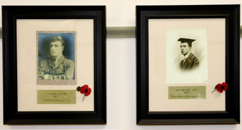 Framed portrait photographs of Noel Chavasse and George Allan Maling with poppies attached to each frame
