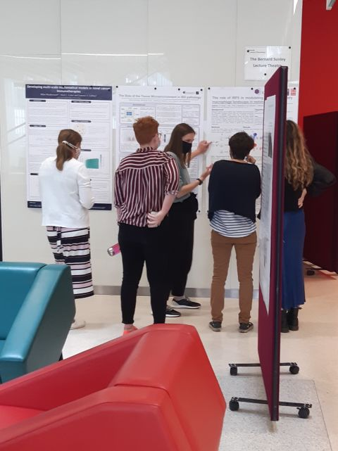 Students view the research posters on display at the Kennedy symposium