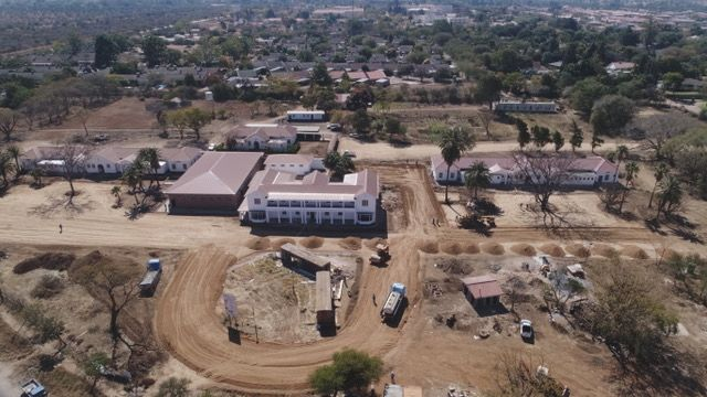 Drone view from August 2019. Admin building (middle) with offices looking onto upstairs veranda, new theatres to the left of admin and children ward left of that. Adult private ward on right.