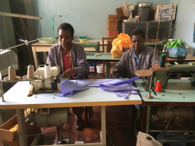 Tailors using surplus theatre curtains to sew PPE