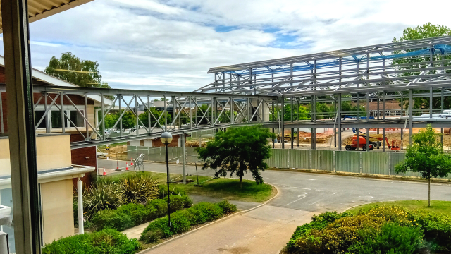 The building of the Marcela Botnar Wing is under way with the skeleton of the frame in place including a walkway that will link the buildings together