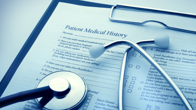 Doctor with a clipboard with a patients medical history and notes