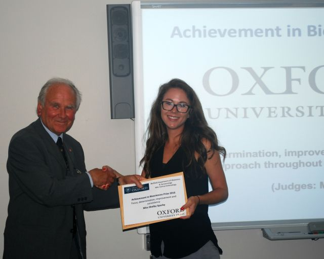 Professor Sir Richard Gardner presenting the Achievement in Biosciences Award 2015/2016 to Miss Shelby Sparby.