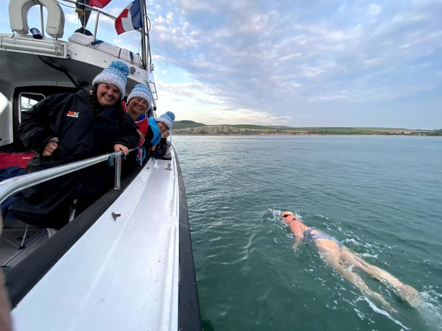 Emma nearing France,  swimming next to the support boat