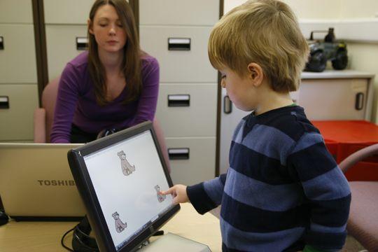 Dr Debbie Gooch working with a pre-school child