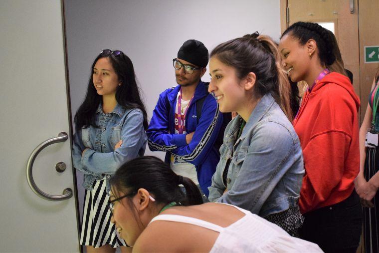 UNIQ students examine an MRI machine