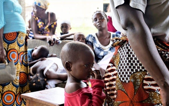 Parents and children at a screening at the KIMORU study site, in Kinshasa DR Congo.