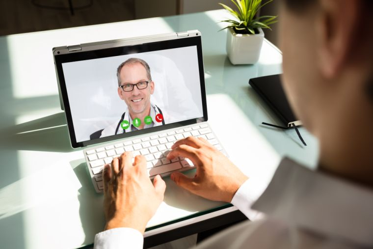 Man doing video conference with doctor on a laptop