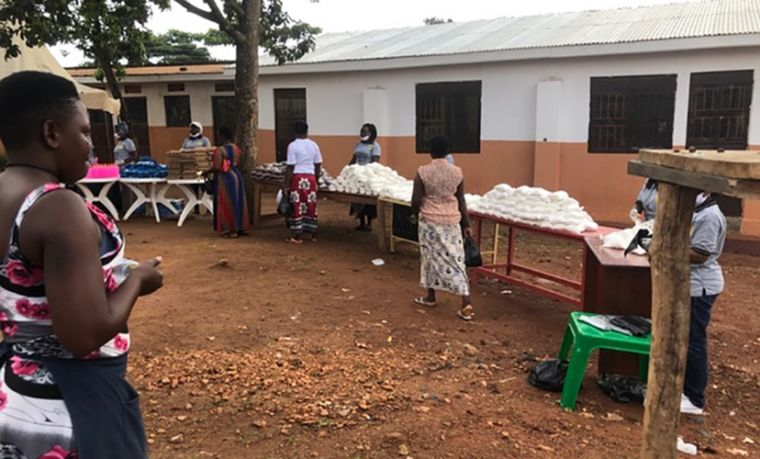 Providing supplies at Hope of Children and Women Victims of Violence (HOCW) in Uganda, with social distancing