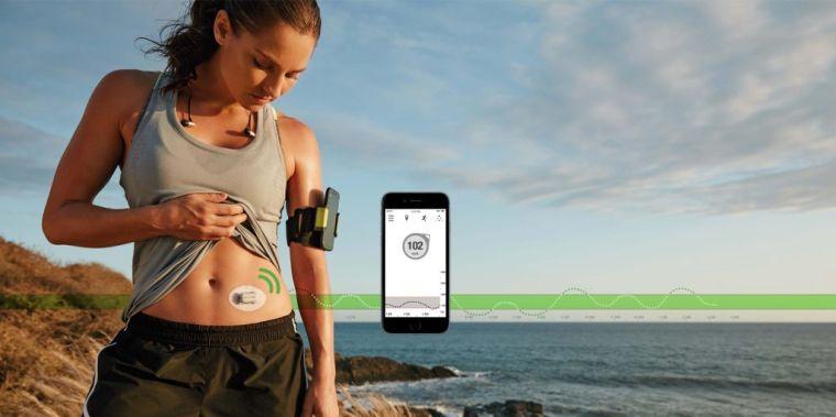 Female runner demonstrating glucose monitoring for mobile phone