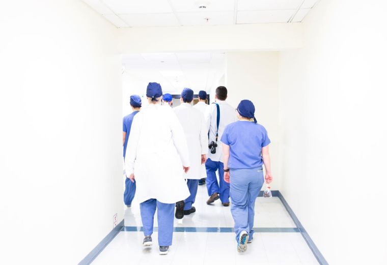 Health care workers walking down corridor