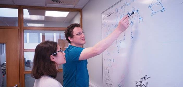 Professor Tim Behrens writing on a whiteboard