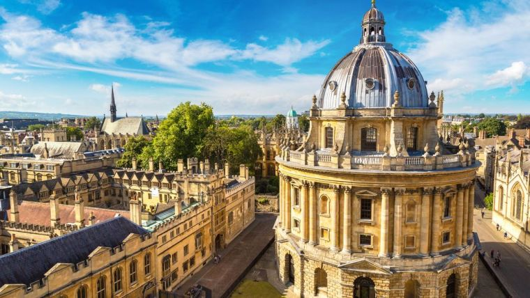 Image of Oxford University buildings with blue sky and sunshine