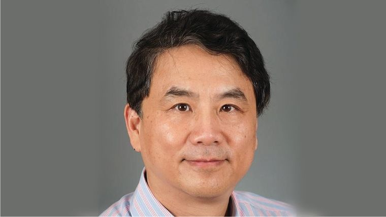 A headshot profile photo of Yang Shi