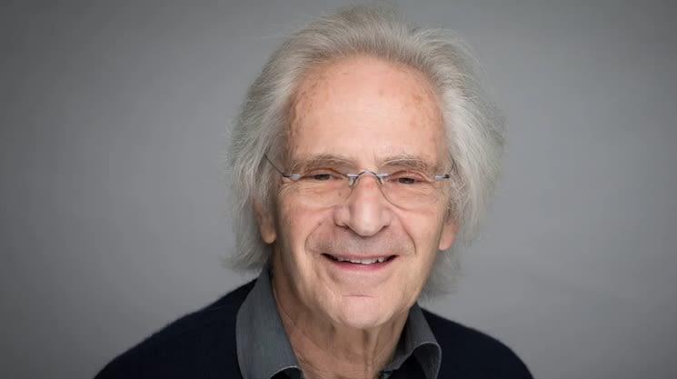 Sir Marc Feldmann smiling