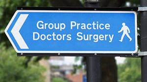 A blue sign for a GP surgery