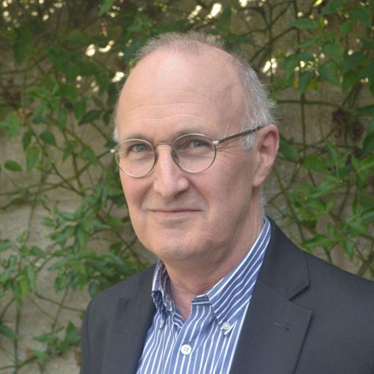 Close-up portrait of Professor John Gallacher