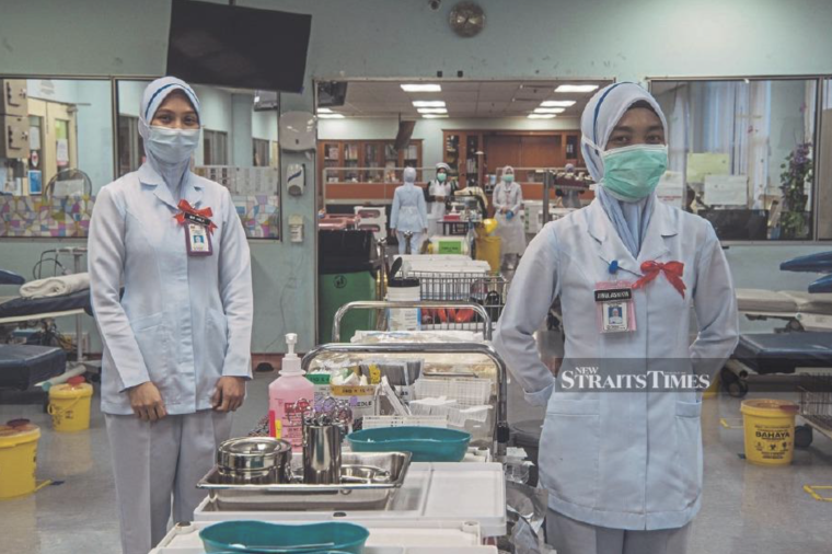 Two health care workers in a hospital
