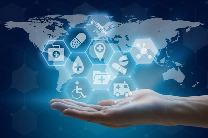 Hand holding global network using modern medical and health care interface
