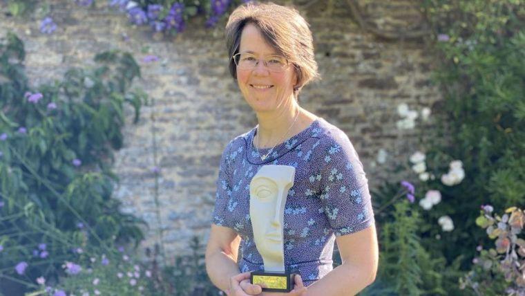 Professor Marian Knight holding award