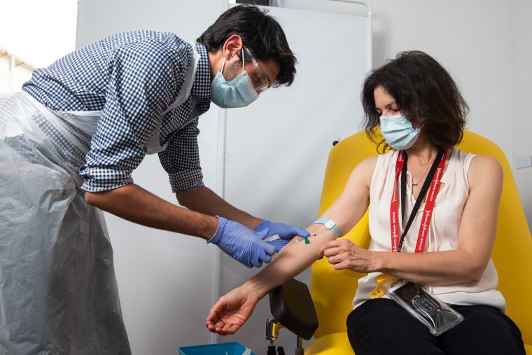 Trial participant having a blood sample taken.
