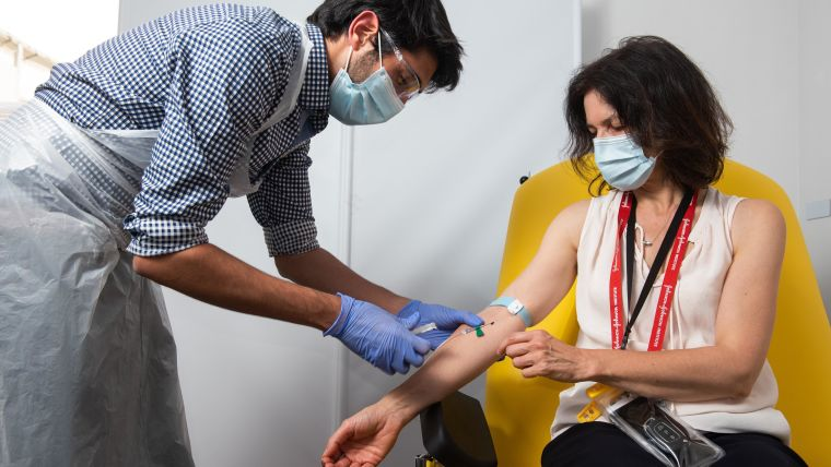 Trial participant having a blood sample taken.