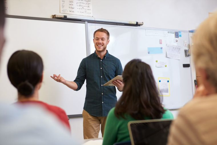 Student in classroom presenting to other students