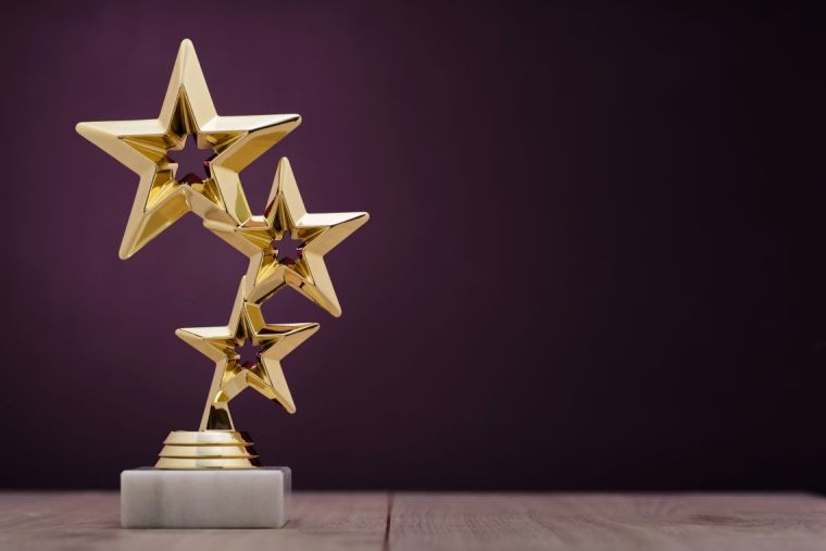 Image of gold award made in the shape of 3 stars.