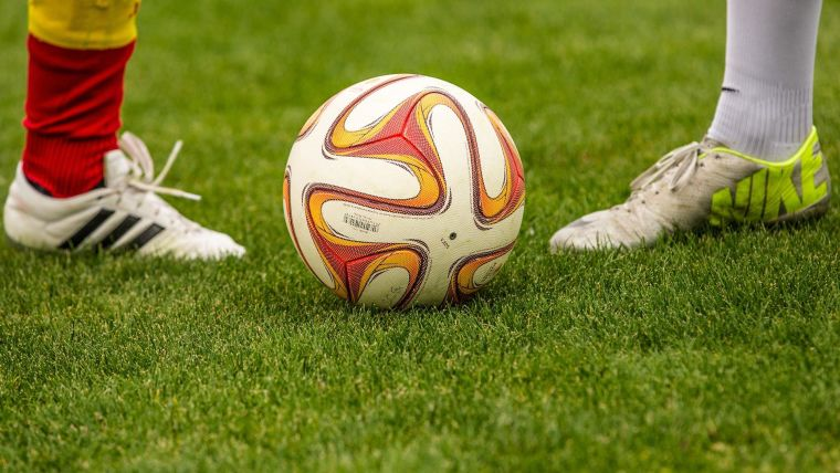 Football with players' feet