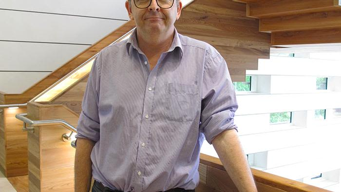 Paul Newton standing in a research building, Headington, Oxford