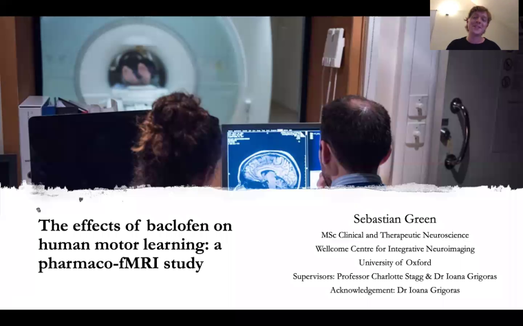 Two radiographers looking at screen in MRI control room