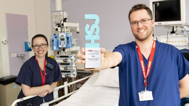 Dr Claire Pickering and Dr Chris Gough hold their HSJ award.