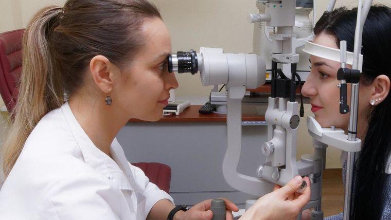 A woman having an eye test with an optician