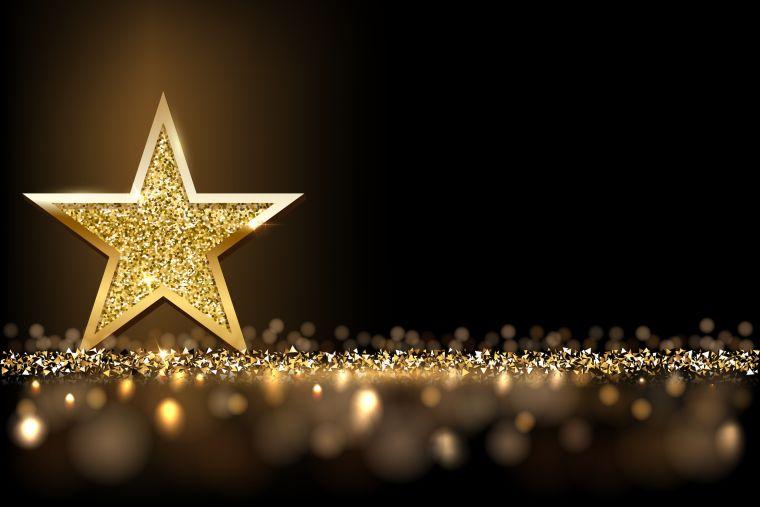 Golden star on black background - award photo.