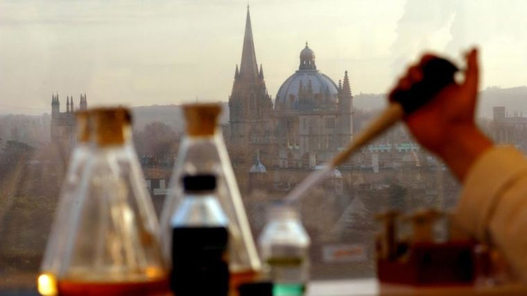 vaccine with Oxford University buildings in the background