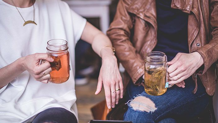 Two people chatting over a cup of tea