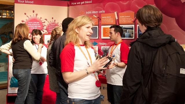 Researchers talking to the public at the Natural History Museum