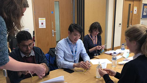 Participants gaining practical tips on teaching whilst at work from an experienced faculty of surgical educator  during the Basics for Medical Education Course.