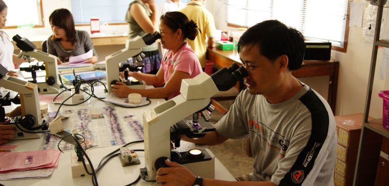 Researchers using microscopes