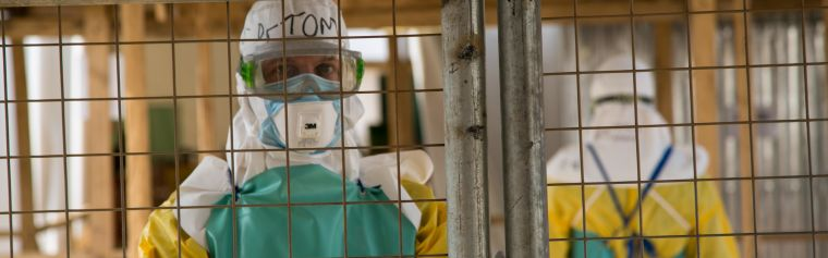 Nurse behind a barbed wire