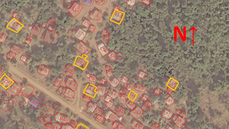 Satellite image of a rural village with the houses numbered