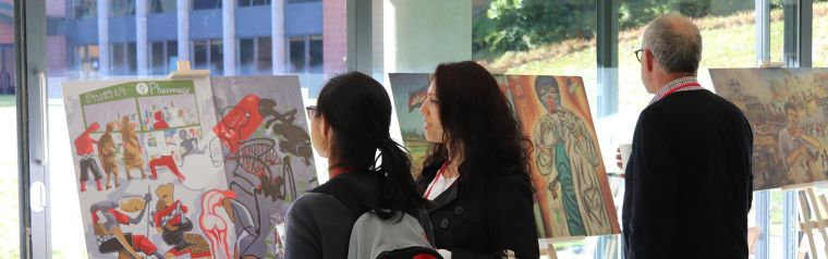 Three people attending an Art exhibition