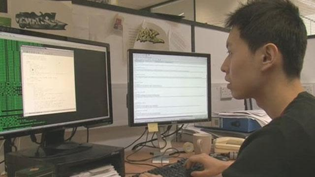 Yang Li working on the computer