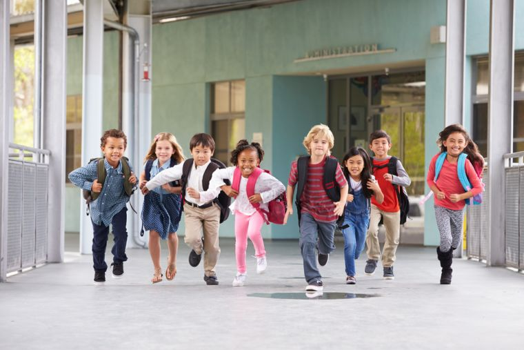 Group of primary school age children running.