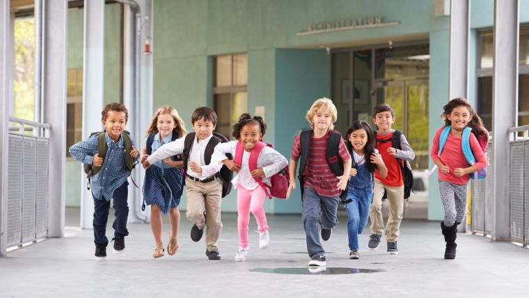 Group of primary school age children running.
