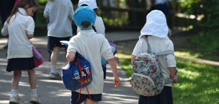 Primary school children running into school