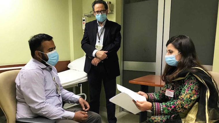 Pakistan Principal Investigator Prof. M. Asim Beg and two colleagues in a hospital setting.