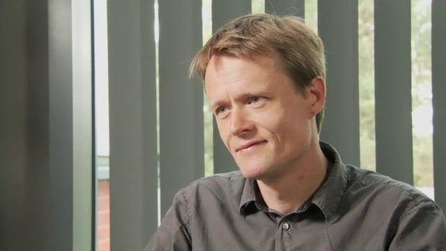 A photo of Mads Gyrd-Hansen talking during the recording of the podcast