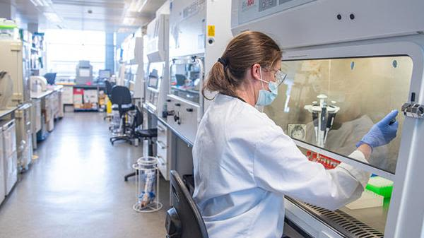 Woman working at lab bench